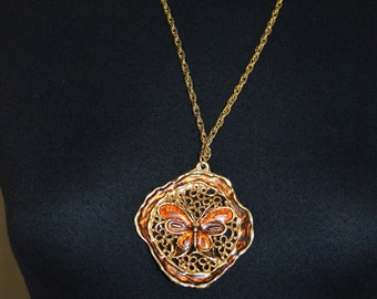 Retro 90s Large chunky Necklace with enamel butterfly and scroll Pendant design. Orange Brown Gold Tone Metal.