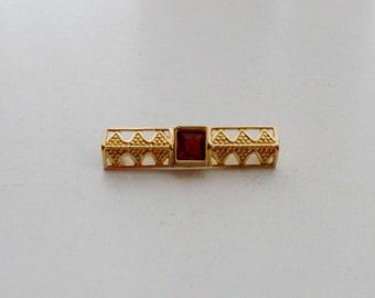 Goldtone Ruby Bar Brooch