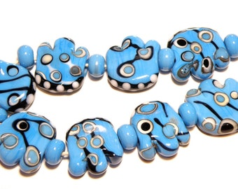 70% OFF -- DESTASH -- Coordinating Set of 17 Funky Shaped Turquoise Blue, Black, and White Lampwork Beads in Tribal Pattern - Lot C