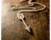 the artemis key - necklace featuring dapper silvertone arrow held captive by silvertone chain