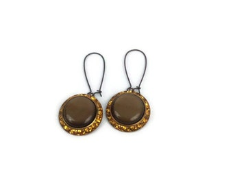 1960s chocolate brown thermofoil earrings with amber rhinestones