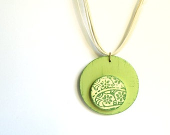 Green Wooden CIRCLES necklace with cream organza and cord.