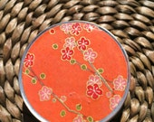 Petite Plum blossoms on Orange Chiyogami -1 oz Screw Top Round Tins - Stash your secrets in this screw top tin-Resin protected Chiyogami top