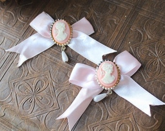 Beautiful cameo pin  with pink color bow   2 pieces listing