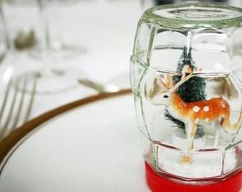 Vintage style handmade diorama snow globe. Waterless winter scene.