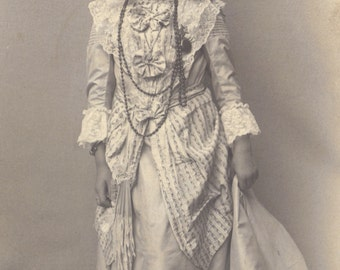 Pretty Little Girl in Fancy Dress with Assorted Baubles, Ruffles and Bows. French RPPC circa 1905