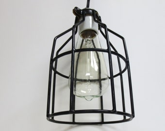 Hanging light fixture with industrial cage in black finish and antique Edison style light bulb - ready to hang