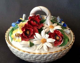Lidded Bowl/Basket Scattered with Bright Summer Florals. Intricate fabrication of Porcelain Flowers. Perky and Functional.