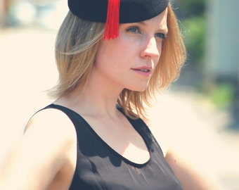 Oriental Twist black felt hat with red tassel