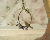 Swinging Bird and Lavender Glass Flowers
