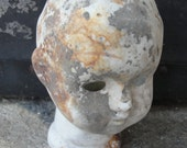 Weathered bisque doll head