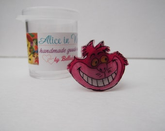 cheshire cat grin adjustable ring shrink plastic unique alice in wonderland handmade jewelry fun quirky curious pink kitty jewelry