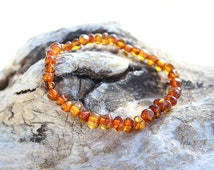 Elastic cognac color Baltic Amber bracelet for babies