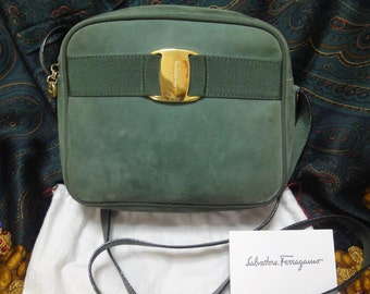 Vintage Salvatore Ferragamo vara collection green suede leather shoulder bag with gold tone bow charm. Classic Ferragamo purse for daily use