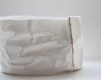 Small vessel. Crumpled paper looking vessel made out of fine bone china with real gold lines