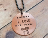 """Miscarriage Pendant Reads """"Someone I Love Was Never Born"""" with Footprints on a Ball Chain Necklace"""
