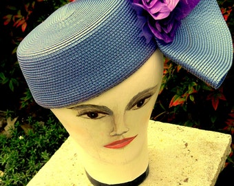 purple straw hat with pink flowers