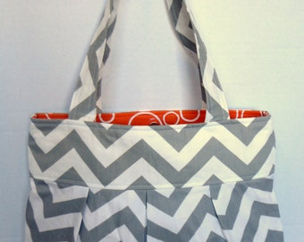 Pleated Hand Bag, purse or diaper bag in gray and white chevron with orange and white swirl lining and three pockets.