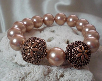 Rose Gold Pearls with Copper Filigree Bead Statement Bracelet embellished with crystals from Swarovski®