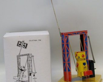 Tin Litho Windup Robot on a Swing MS366 with Key, mint in box