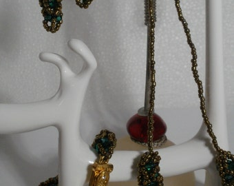 Beadwiving set bracelet earrings and necklace gold beads and swarovski green crystal