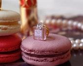 Dior Cherie perfume brooch