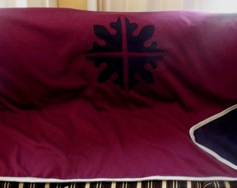 Super warm blanket with reverse applique motif, made from Australian made fleecy