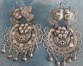 SALE Frida Kahlo style earrings, lovebirds, flower and leaves surrounded by filigree, fringed with silver balls.