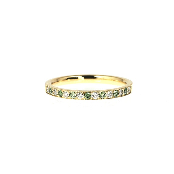 Green And White Diamond Wedding Band Made From Yellow Gold