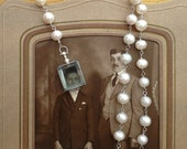 big white pearl chain with rectangular locket and front toggle closure