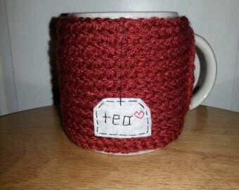 knitted tea cup cozy mug cozy in terra cotta brick