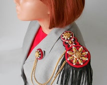 Red / black / gold color beaded epaulet on your extravagant appearance.