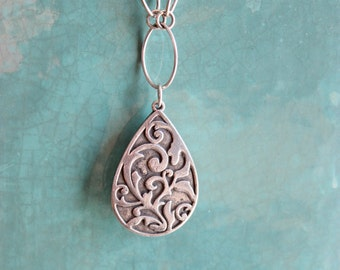 ALL STERLING SILVER Engraved Scrolled Silver Pendant hangs from a Oval and Round link chain
