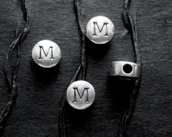 2  STERLING Silver Beads with the Letter M Stamped on both Sides - 7mm Wide x 4mm Thick  -  Hole is 3mm and Horizontal