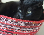Cuddly cat snuggle bed - red, white and black