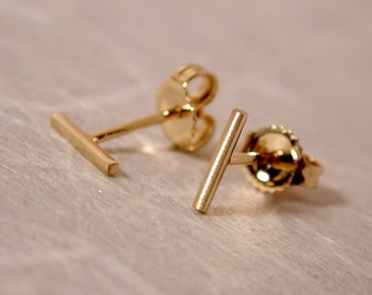 7mm x 1mm Brushed 14k Yellow Gold Bar Studs Small Minimal Earrings by SARANTOS