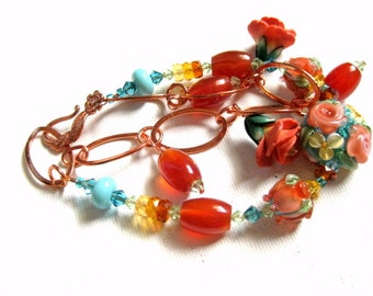 Copper, lampwork, & carnelian floral charm bracelet
