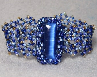 Across the Great Divide, beadwoven bracelet with fiber optic glass cabochon