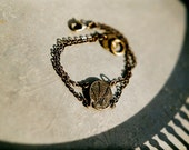 At the cemetery gate - bracelet with blackened brass fern cameo and keyhole closure