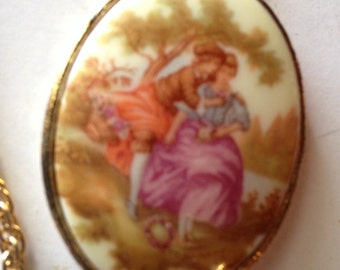 Vintage Courting Couple and Mirror Goldtone Pendant Necklace