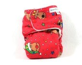 Final Clearance: Small fitted Christmas cloth diaper made with OBV features Rudolph and reindeer friends on red.