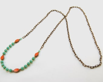 very long teal and orange Czech glass bead and natural brass necklace by CURRICULUM