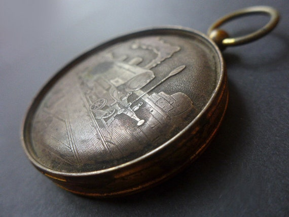 Vintage pocket watch case train medallion pendant.