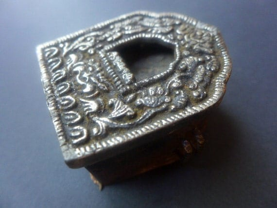Tibetan reliquary prayer box pendant.