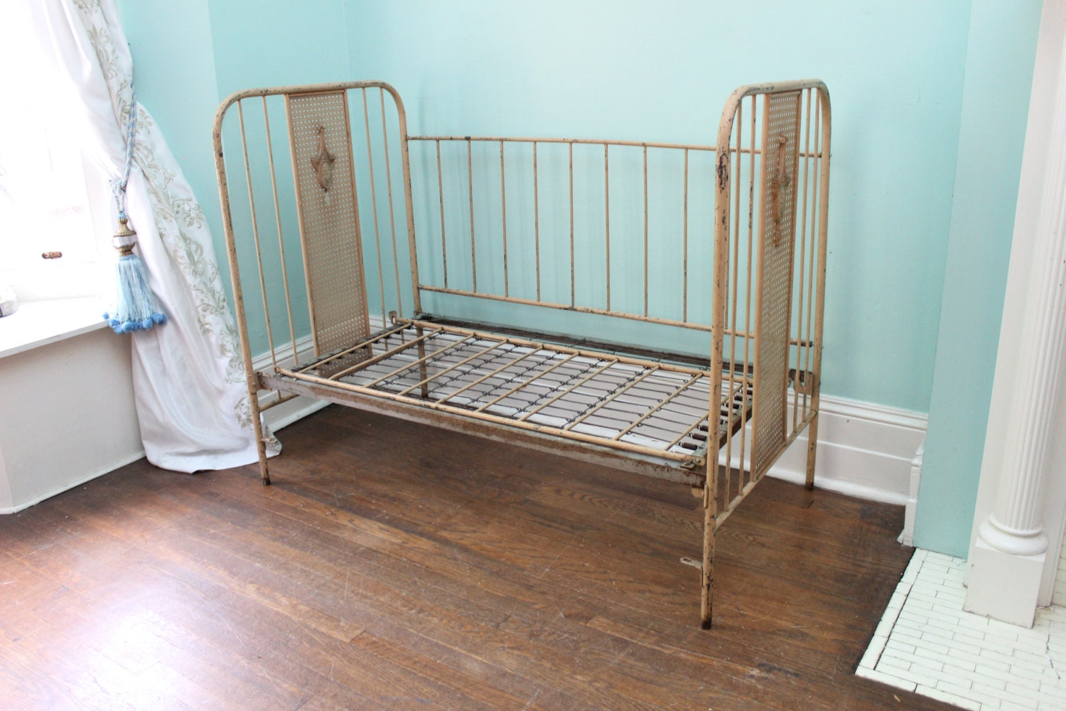 Antique metal swinging bassinet