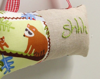 Shhh pillow- doorknob pillow hand embroidered in green on natural linen with raccoon on a branch