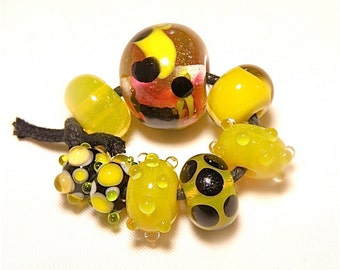 DESTASH -- Eight (8) Lampwork Rondelle Beads  -- Bright  Yellow, Black, and Cherry Red