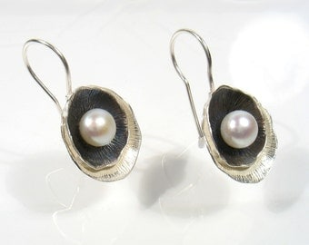 Sterling silver shell in a shell partly oxidized  dangling earrings with fresh water pearl. A pearl is born.