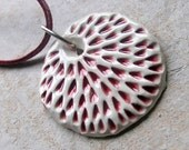 Textured pendant in shades of burgundy and white