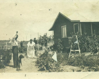 Farm Life Husband Wife Playing With A Dog in the Garden House Summer 1920s Vintage Black And White Photo Photograph